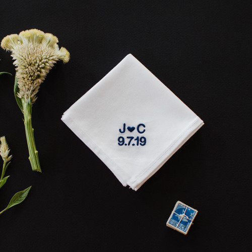 Men's wedding handkerchief for the groom embroidered with the couple's initials and wedding date.