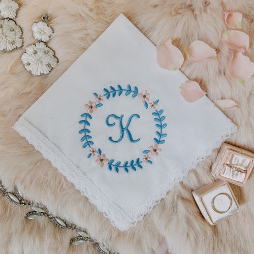 Something blue wedding handkerchief with monogram embroidered in powder blue.