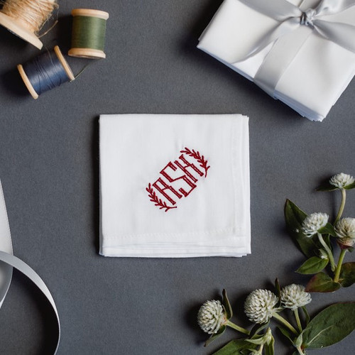 Monogrammed handkerchief embroidered with a vine style monogram.  The handkerchiefs are white with merlot embroidery thread.