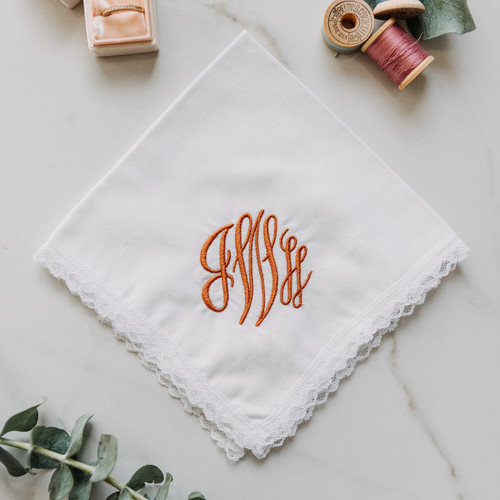 Monogrammed women's handkerchief embroidered in burnt sienna thread color.  Dainty Lace White handkerchief style.