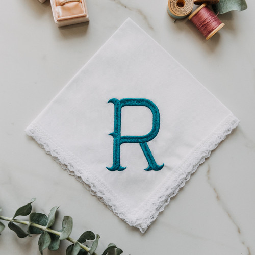 Monogrammed women's handkerchief with large initial in Fish Hook. Embroidery is is shown in peacock. Customer can enter their own initial and pick their embroidery color.
