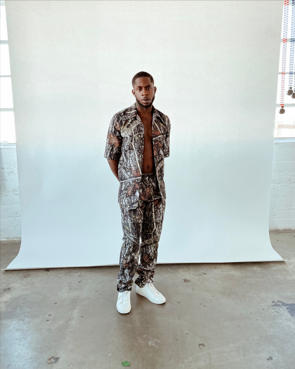 Steelo worn with Pleated Trousers in Forest
