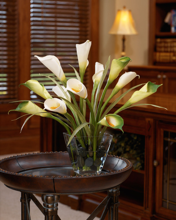 """white green calla lily & foliage silk centerpiece, velvety texture, natural appearance green foliage, black stones in acrylic water in heavy 6"""" square tapered glass vase"""
