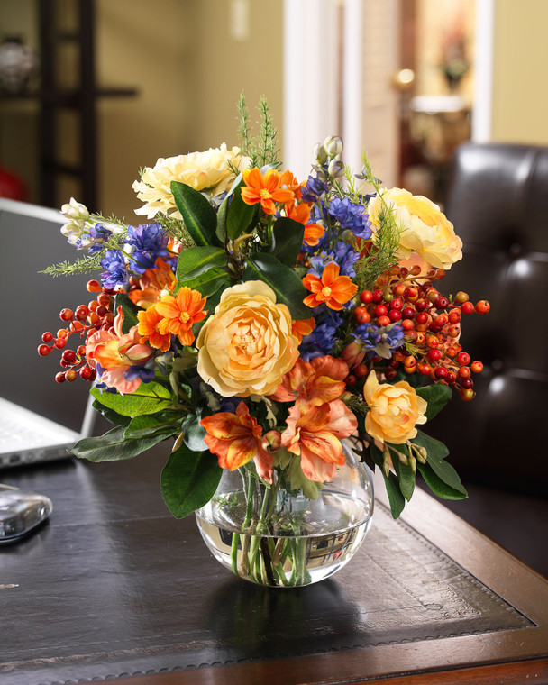 Silk Flower yellow ranunculus, blue delphinium, and colorful berries and coral alstroemeria