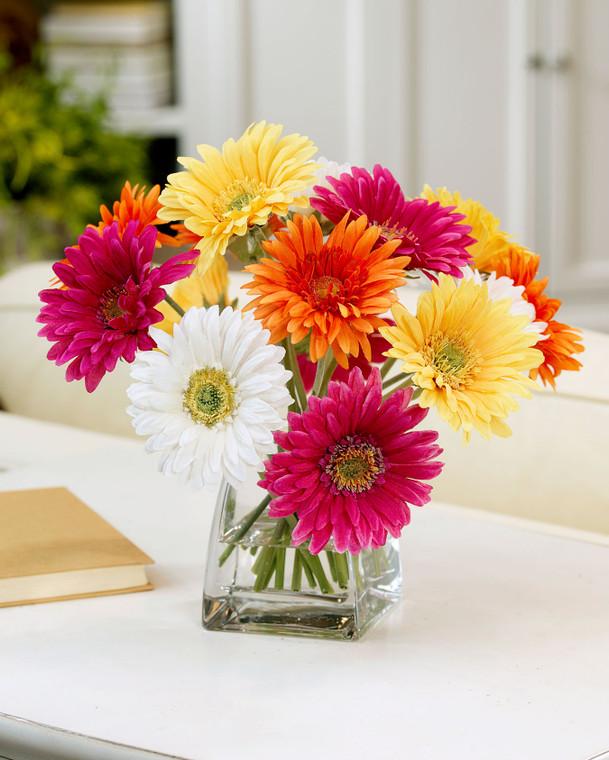Colorful lifelike silk gerbera daisy centerpiece set in crystal clear acrylic water in glass vase
