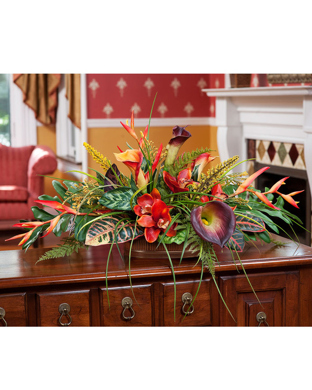 Tropical orchid, calla lily and croton leaves low centerpiece silk flower arrangement