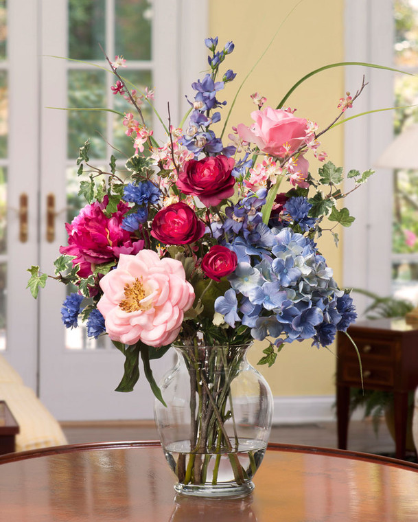 """Gorgeous Painter's Palette Silk Flower Arrangement in Mixed Soft Tones designed in a 7"""" jardin vase of crystal clear acrylic water"""