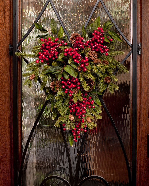 """Pine and berry silk swag 16"""" wide teardrop of pine winter greens and cones with shiny red berries on a decorative metal base"""