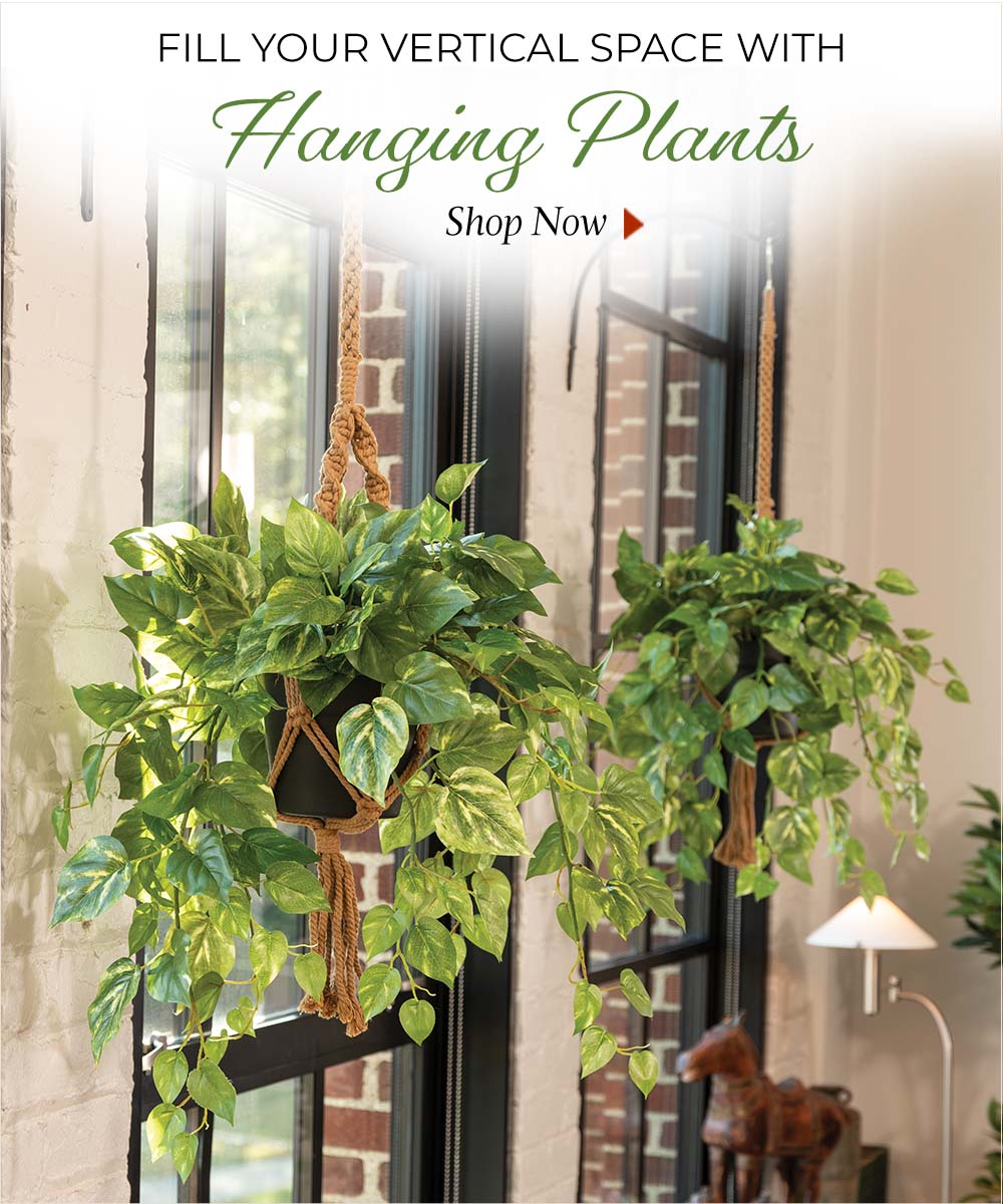 Fill your vertical space with hanging artificial plants, available at Petals.