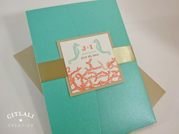 Aqua, Coral & Sand Coral Reef & Seahorses Destination Beach Wedding Invitations in an Aqua pocket folder
