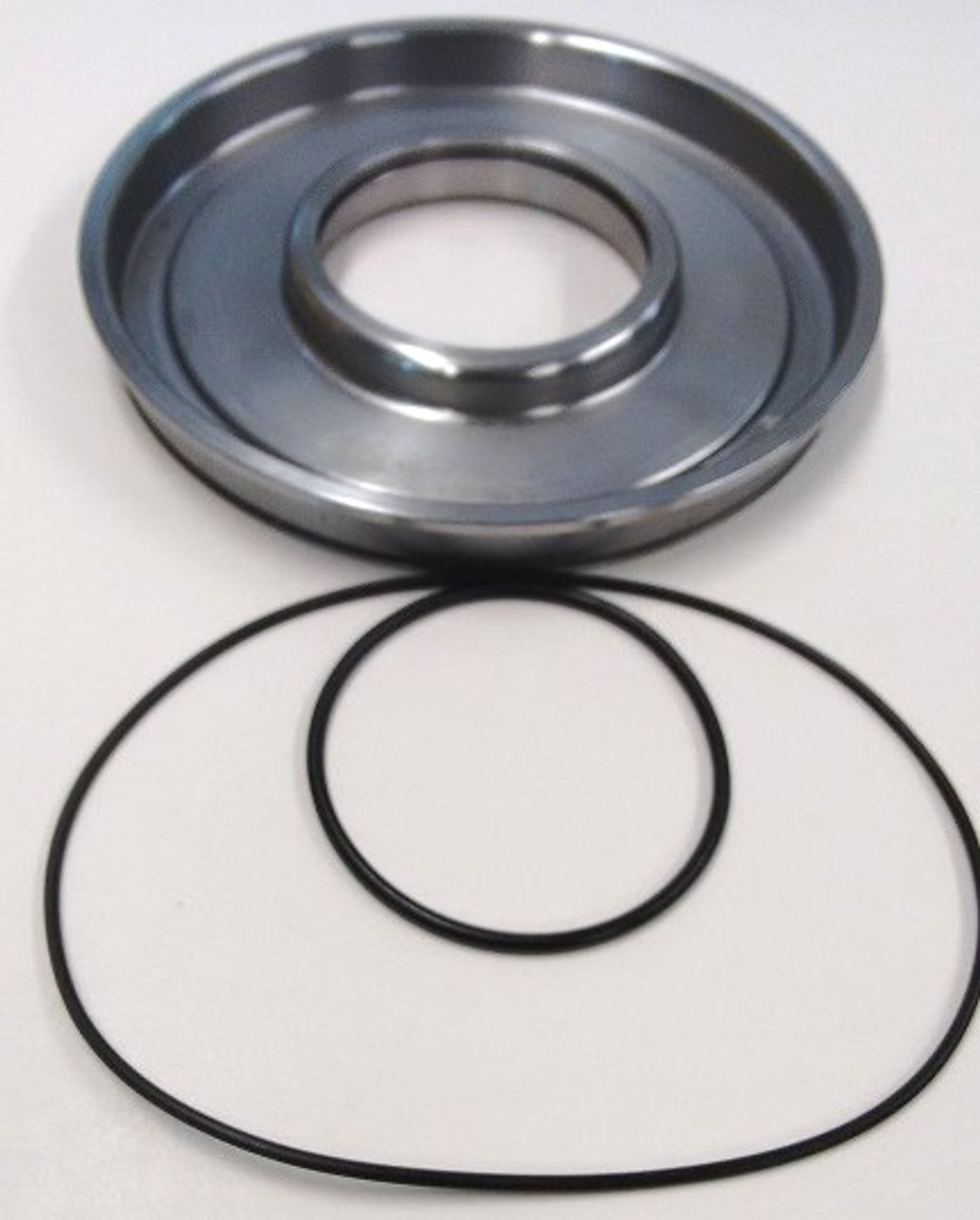 This is a new design piston made from steel with 2 Viton O-Rings  Top view