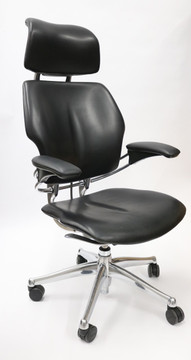 Freedom Chair By Humanscale Fully Adjustable Model With Headrest Polished Frame and Black Leather