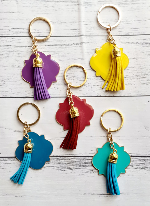 5cm enamel tassel keyrings with gold plated metal base.  These gorgeous little keychains can be personalised with names