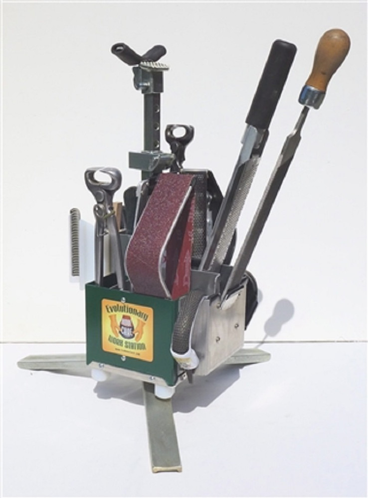 The Evo Complete Hoof Care Work Station - Deluxe shown in mount to stand position holding a large set of tools (tools not included).  The tool Caddy is easily removable from the stand (see video).