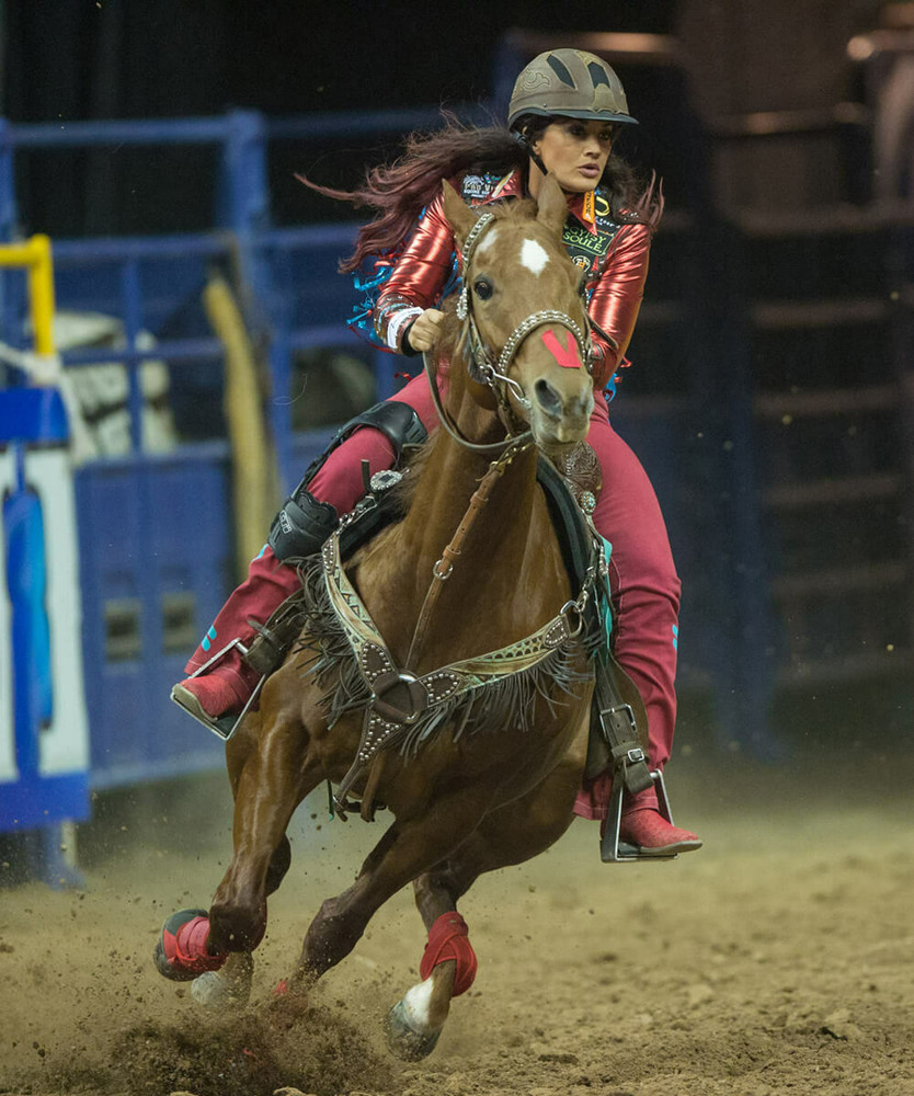 The Troxel Cheyenne Helmet on a professsional rider during  an event.