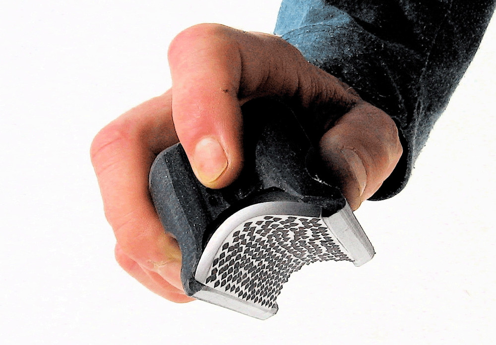 Radius Rasp (RR-2 Pro) shown being held.  Easily fits in the hand with the perfect size and grooves for your fingers.  In this picture you can see the replaceable Stainless Steel rounded rasp blade.  The Black Radius Rasp is courser than the White and is used first when you need a courser blade.