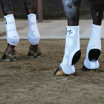 For complete protection for the horse that performs hard stops or tight turns, this Combo 4-Pack comes equipped with VenTECH™ Elite Sports Medicine Boots for the front legs and VenTECH™ Slide-Tec® Skid Boots for the rear legs.  Picture shows a set of White on the horse.