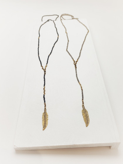 black beads. silver beads, gold leaf charm, beaded necklace, nature-inspired jewelry