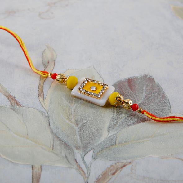 Yellow Fancy Diamond on White Stone Rakhi- For Europe