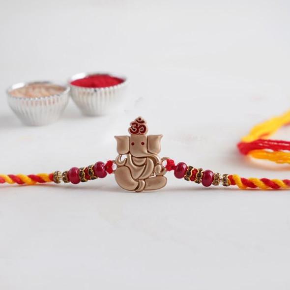 Lord Ganesha Golden Designer Rakhi - For INDIA