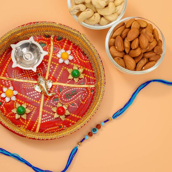 Pleasing Rakhi With Pooja Thali & Dry Fruits - For Australia