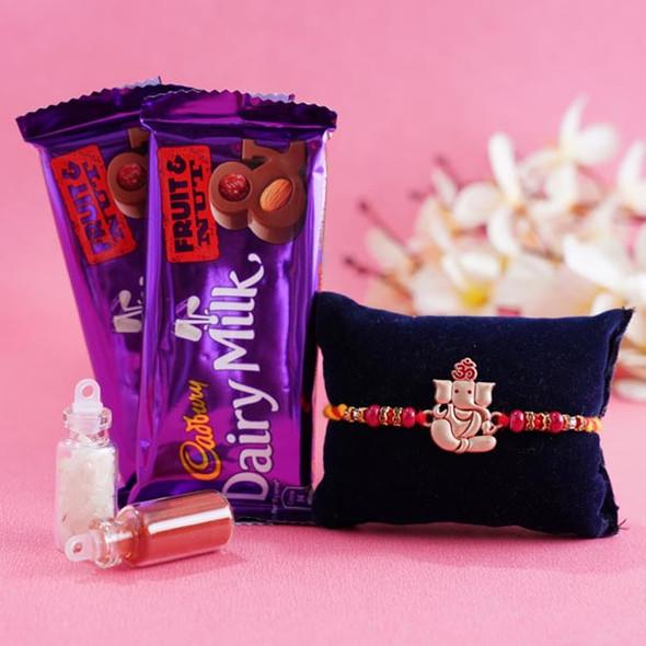 Ganesha Rakhi and Dairy Milk Chocolate Combo - For INDIA