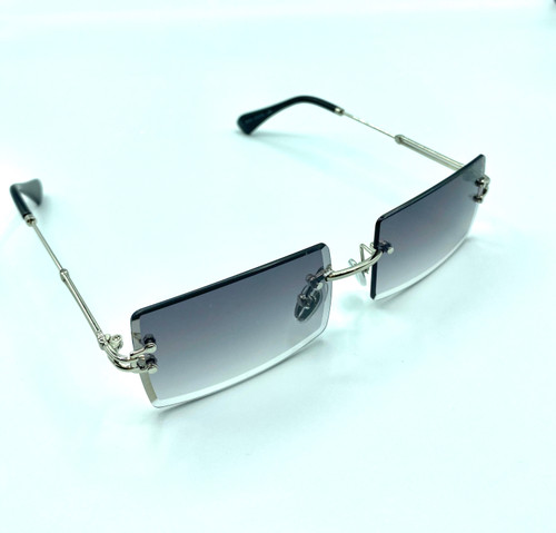 On Trend Women's Fashion Silver Grey Rimless Sunglasses with UV 400 protection.