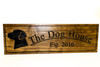 The dog house sign with Labrador