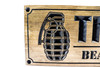 Man cave sign with hand grenade
