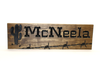 wooden farm and ranch sign with cactus and barb wire