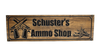 crossed pistols with ammo sign