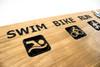 run-bike-swim-triathlon race medal display