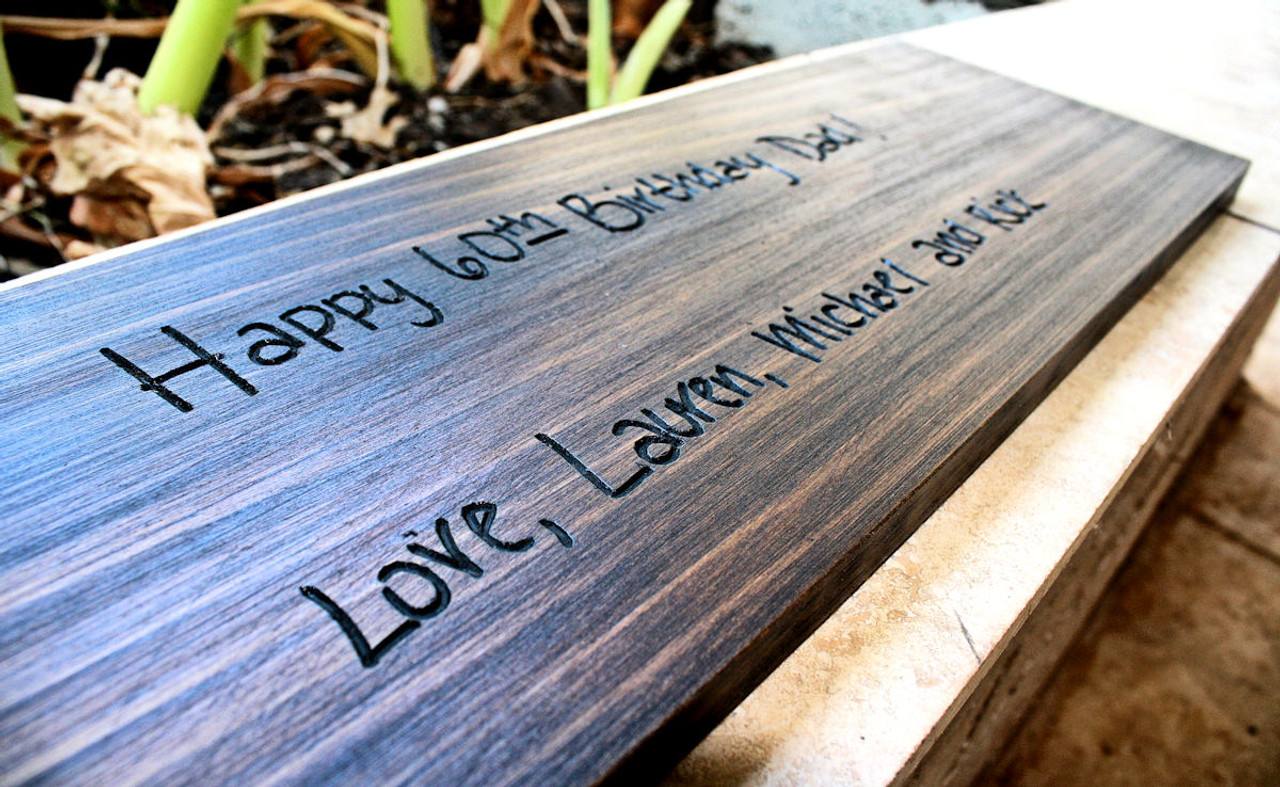 personal handwritten note carved onto a sign