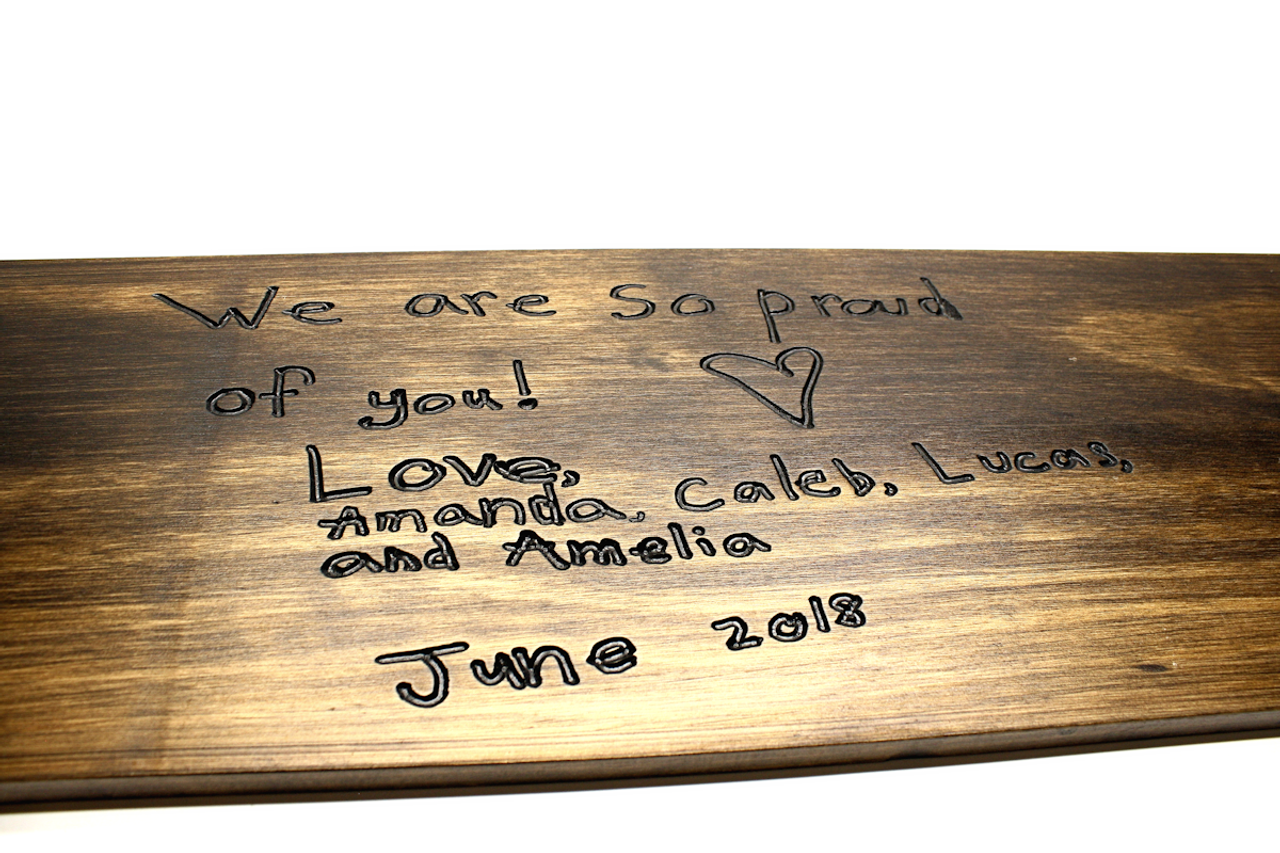 personal handwritten note on a wood sign