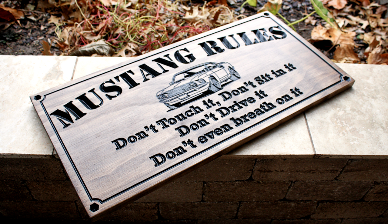 man cave sign with car