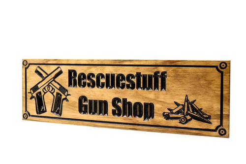 wooden gun shop sign