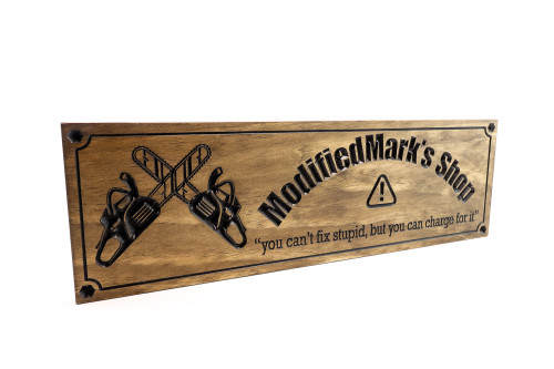 wooden man cave sign with chain saws