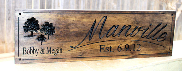 wooden family sign with oak trees