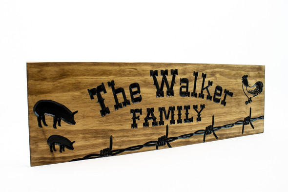 Farm/ranch Sign with barb wire and animals
