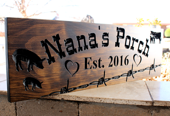 porch sign with animals