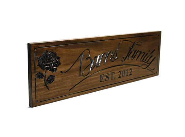 wooden family name sign with rose