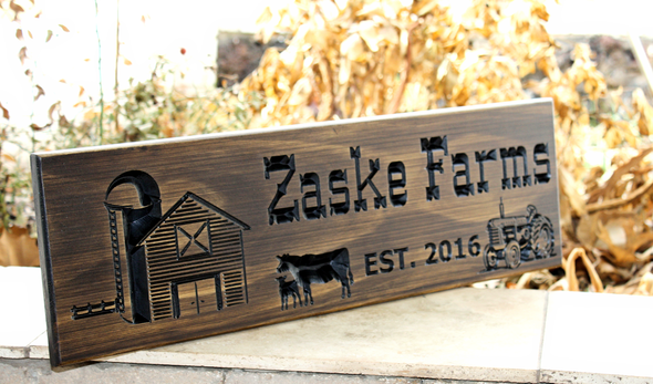Farm/Ranch sign with tractor and barn