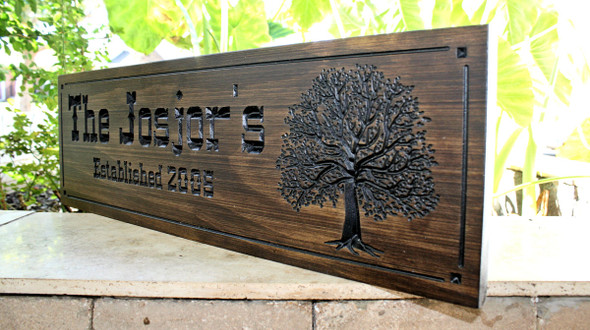 Family Name sign with oak tree