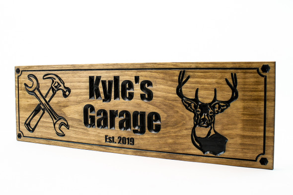 garage shop sign with deer head