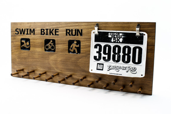 run-bike-swim-triathlon race medal display