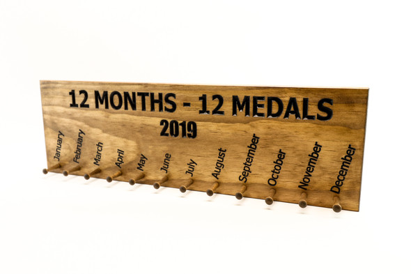 12 months, 12 medals running medal display sign with pegs