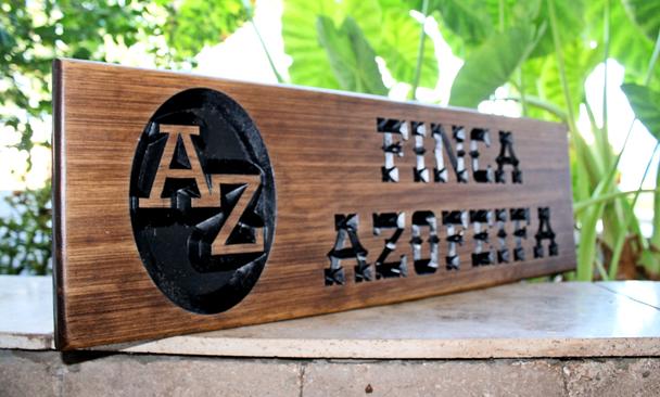 wooden family finca sign