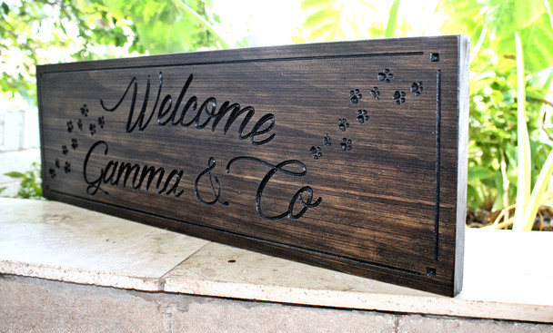 Family name sign with paw prints