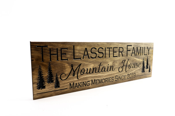 Family name sign with trees