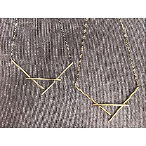 Naked Cradle Necklace in Gold and Silver